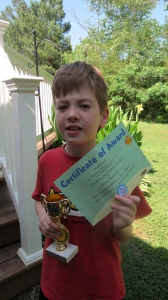 Landon with his Awana award
