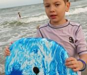 Landon loves playing at the beach