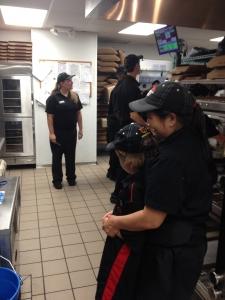 Landon touring kitchen of Pizza hut